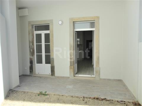 Apartamento T1+1 novo com logradouro, no histórico Bairro da Graça