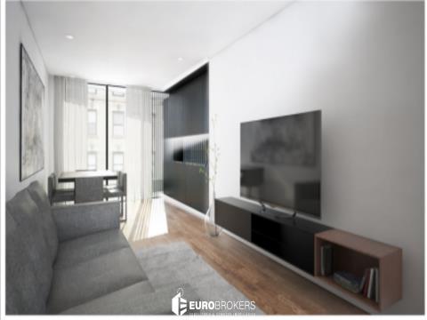 Apartamento T1 novo com terraço e garagem