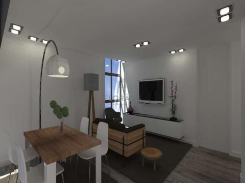 Apartamento T2, situado numa zona habitacional, de comércio e serviços.