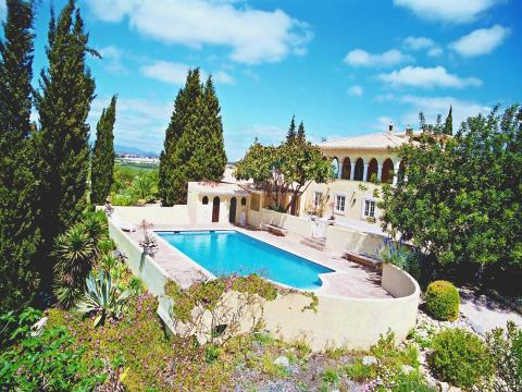 Beautiful Villa with landscaped garden and own vineyard.