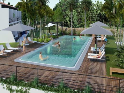 Moradias T2 com box garagem em condomínio com piscina em Alcantarilha